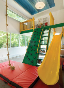 at-the-end-of-a-hall-in-this-home-is-a-14x22-foot-sharpplayroom-that-includes-an-indoor-jungle-gym-rock-climbing-wall-rope-swing-and-a-door-to-the-deck.-sharphousetrends